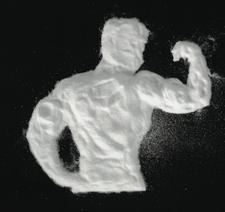 creatine supplement powder shaped like a bodybuilder