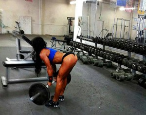 female deadlifting barbell with weights